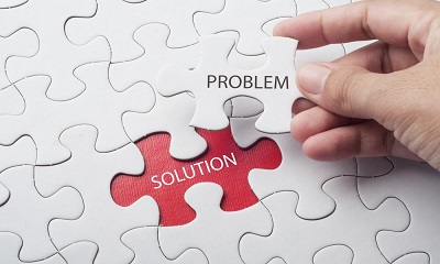 Hand-holding-piece-of-jigsaw-puzzle-with-word-problem-solution